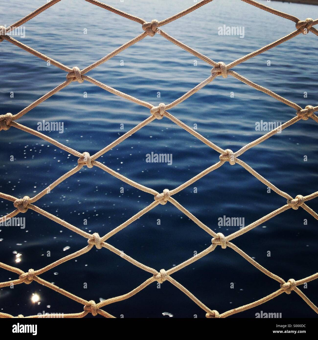 Netting and sea water - Stock Image