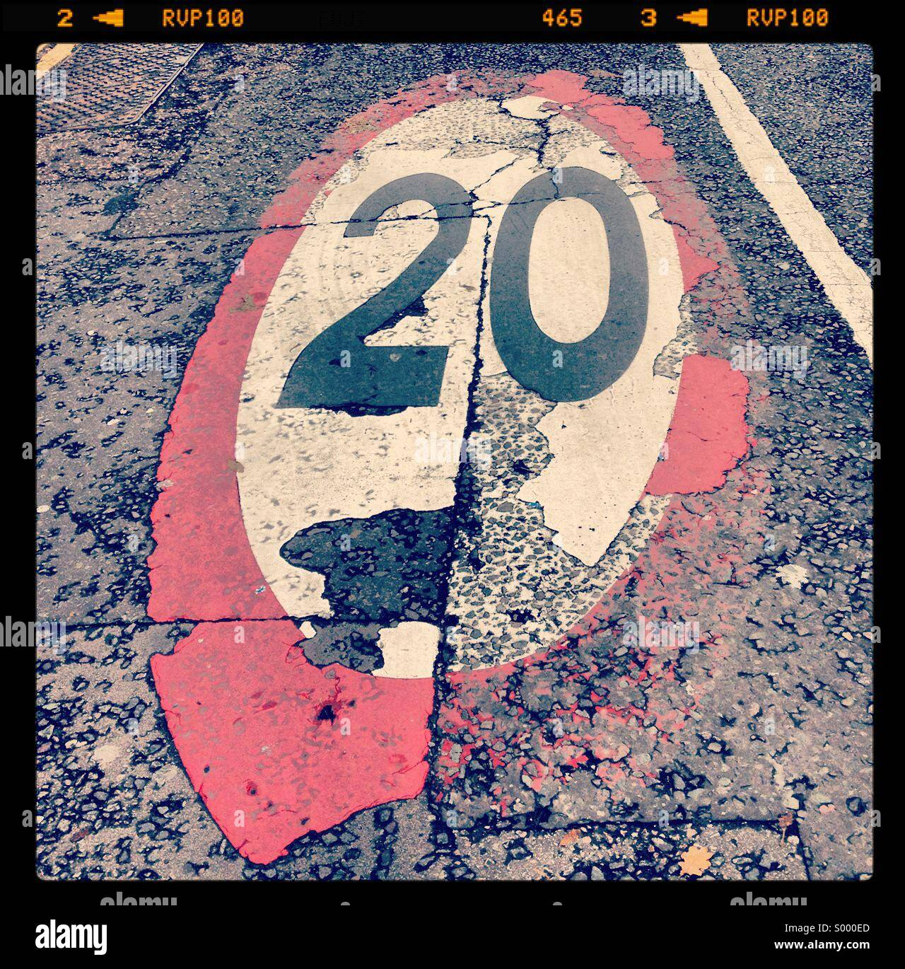 Twenty miles per hour marking on road, London, England - Stock Image