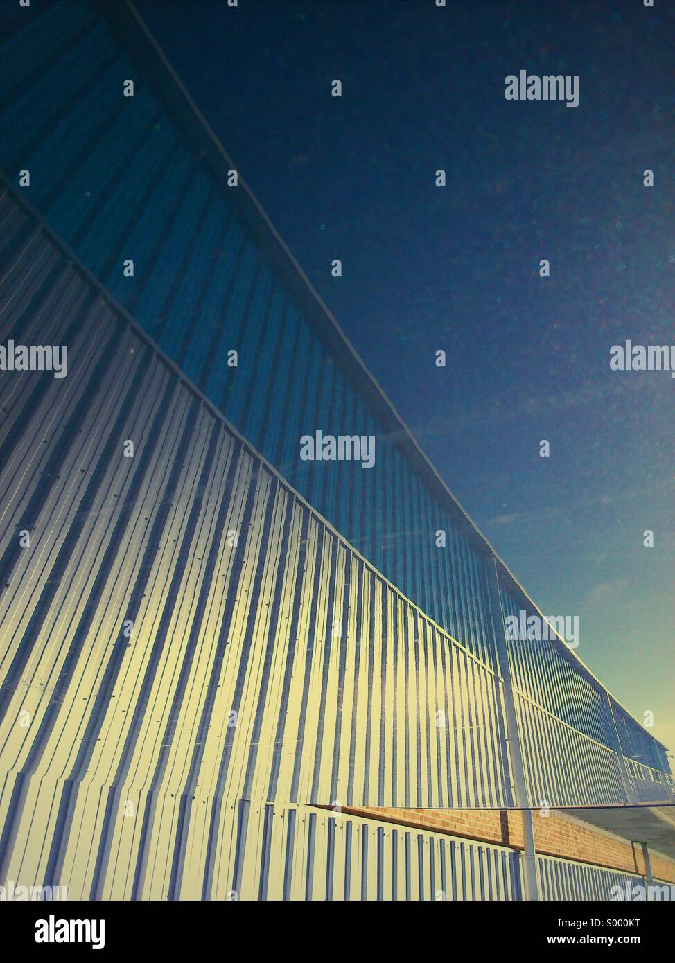 Abstract reflection of building on car roof - Stock Image