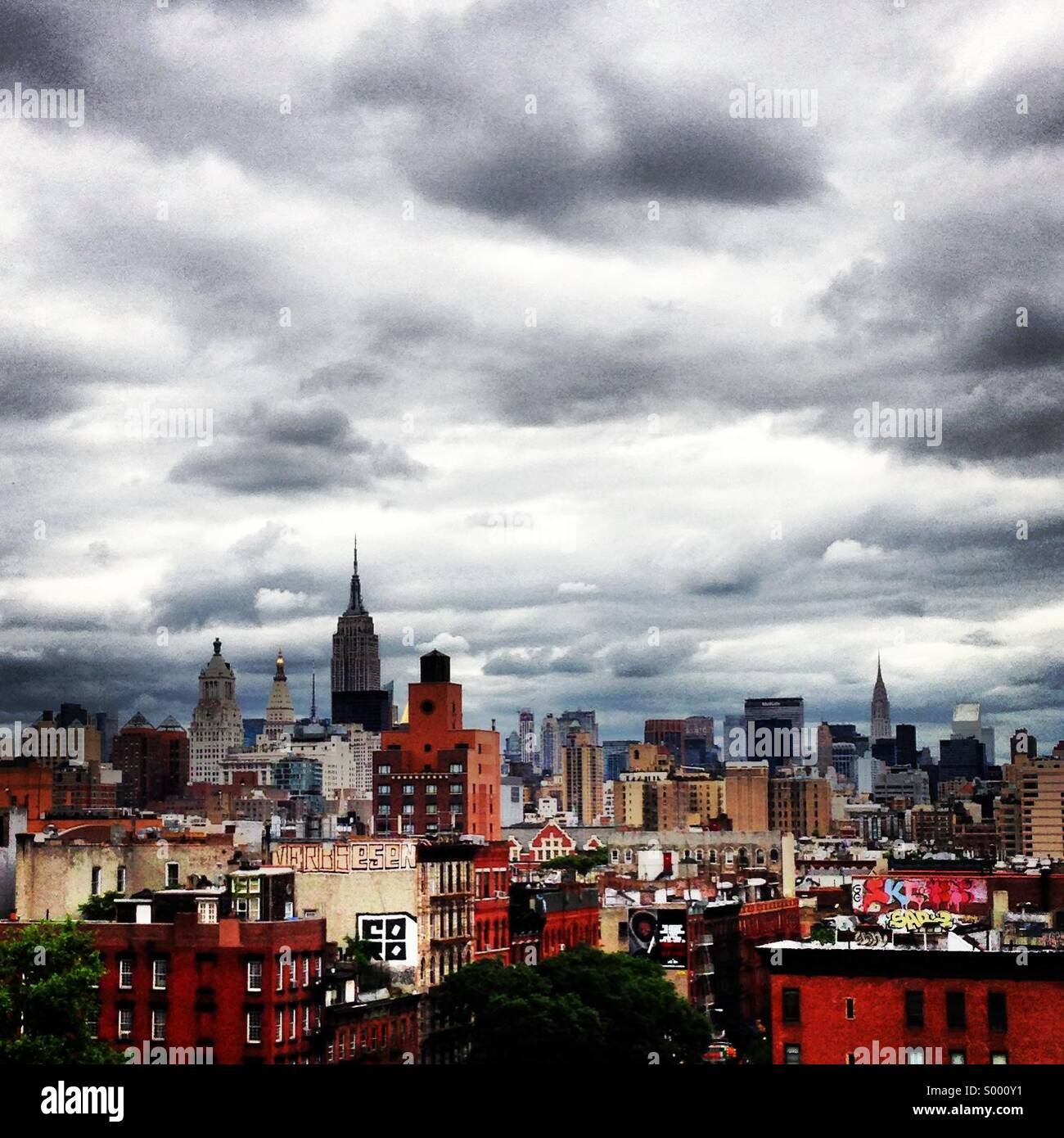 New York City skyline taken from rooftop of Thompson LES hotel - Stock Image