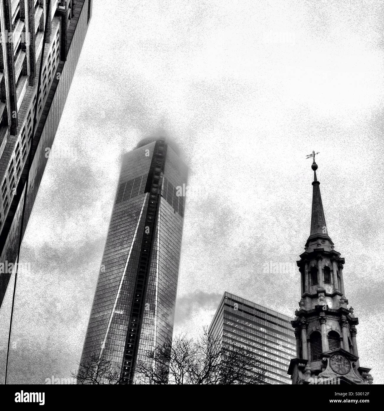 St. Paul's Chapel and the Freedom Tower in a fog. - Stock Image