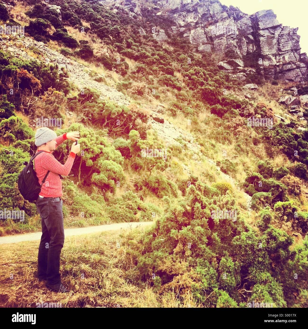 Man taking photograph - Stock Image