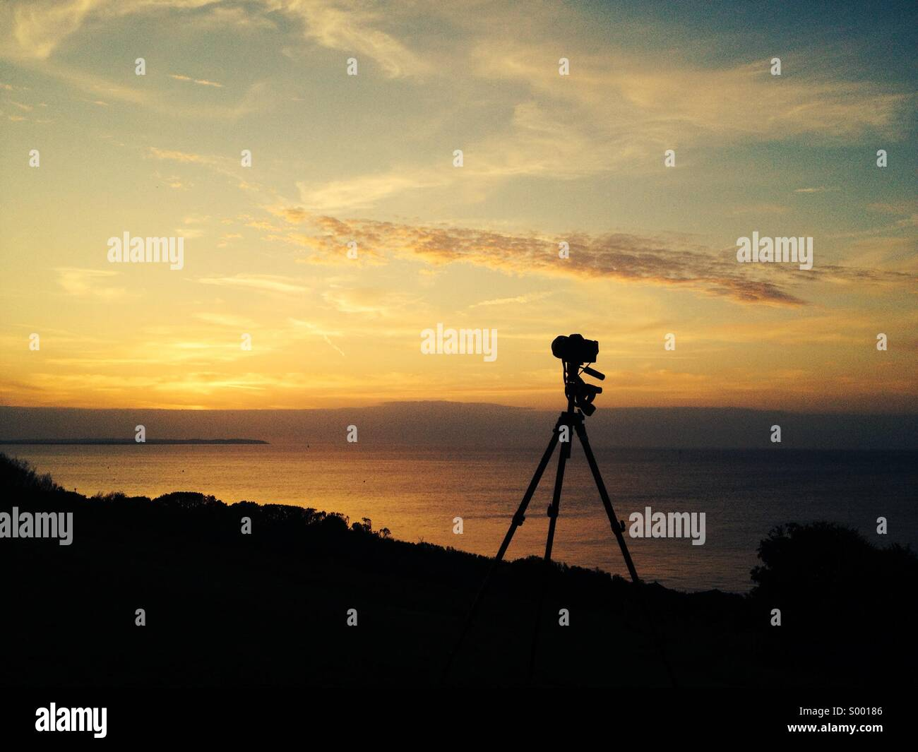 Photographing sunset - Stock Image