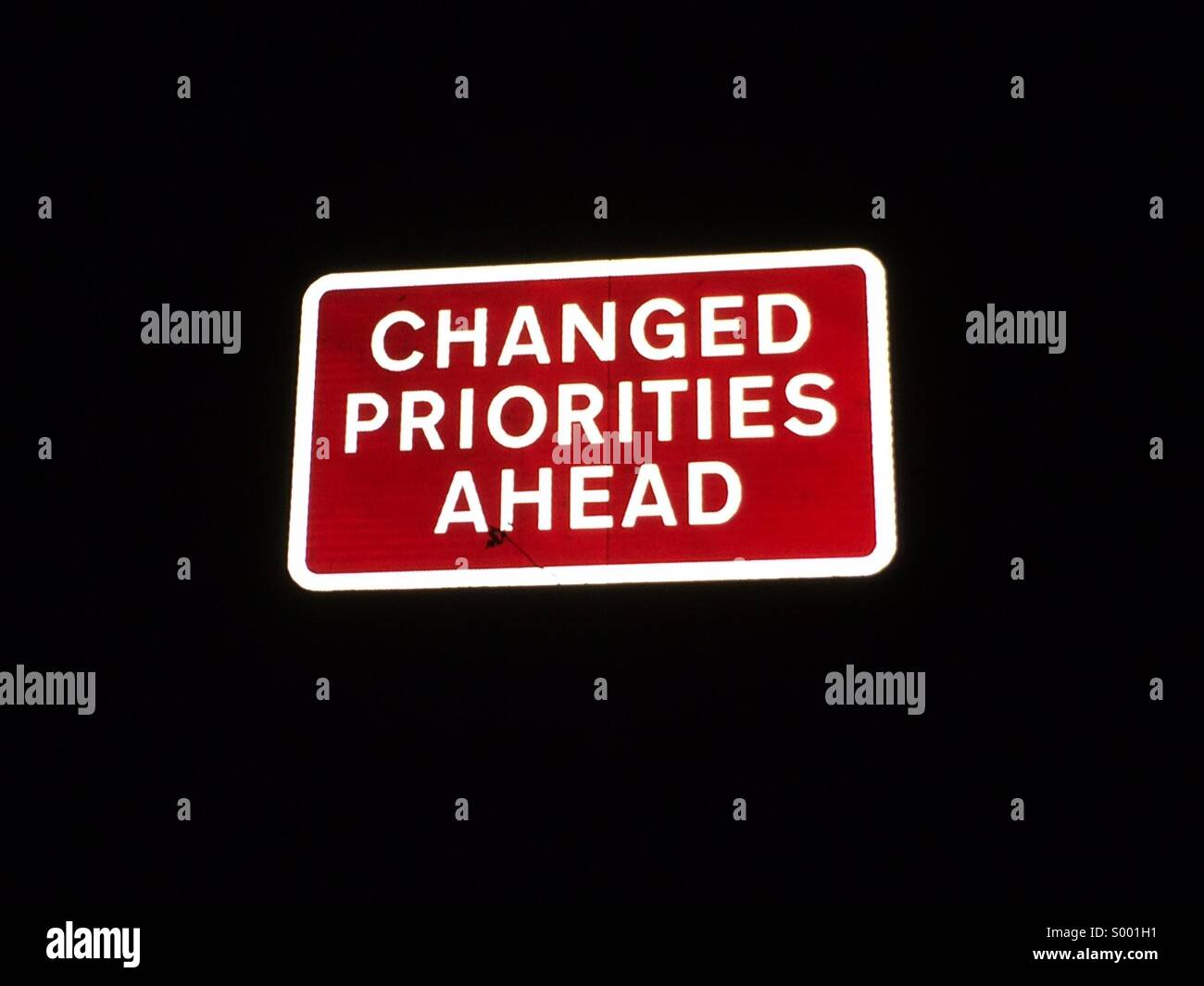 Changed priorities road sign. - Stock Image