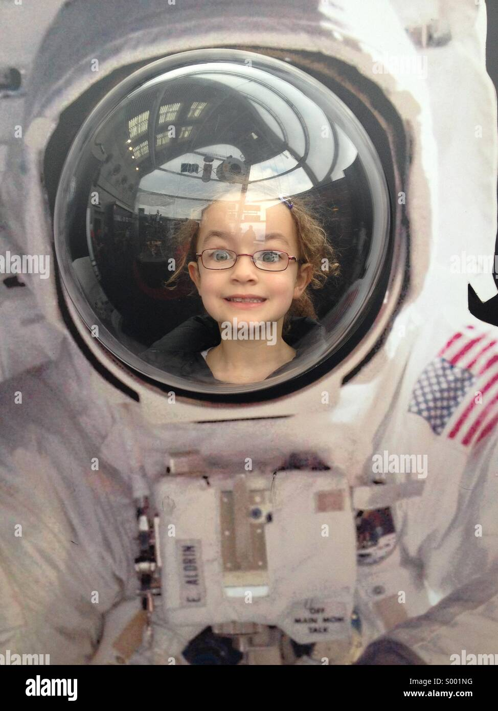 Little girl in an astronauts space suit Stock Photo ...