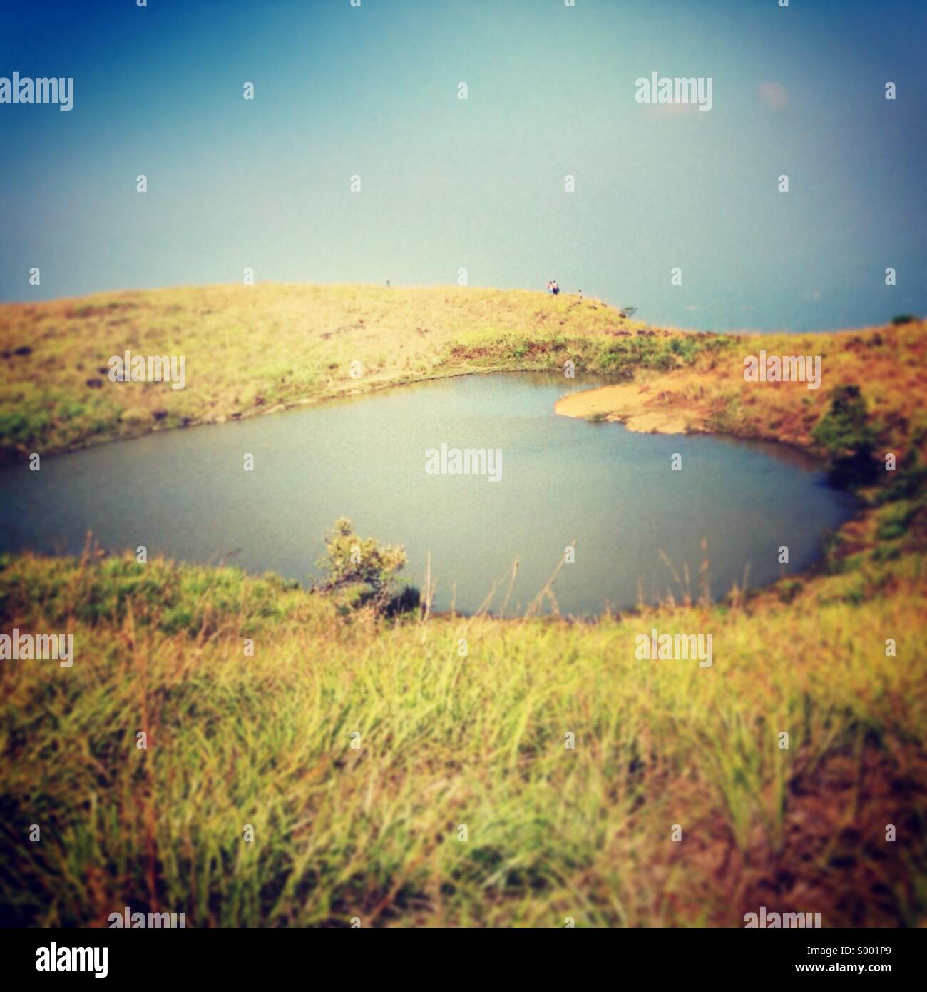 Love shaped lake on hill top - Stock Image