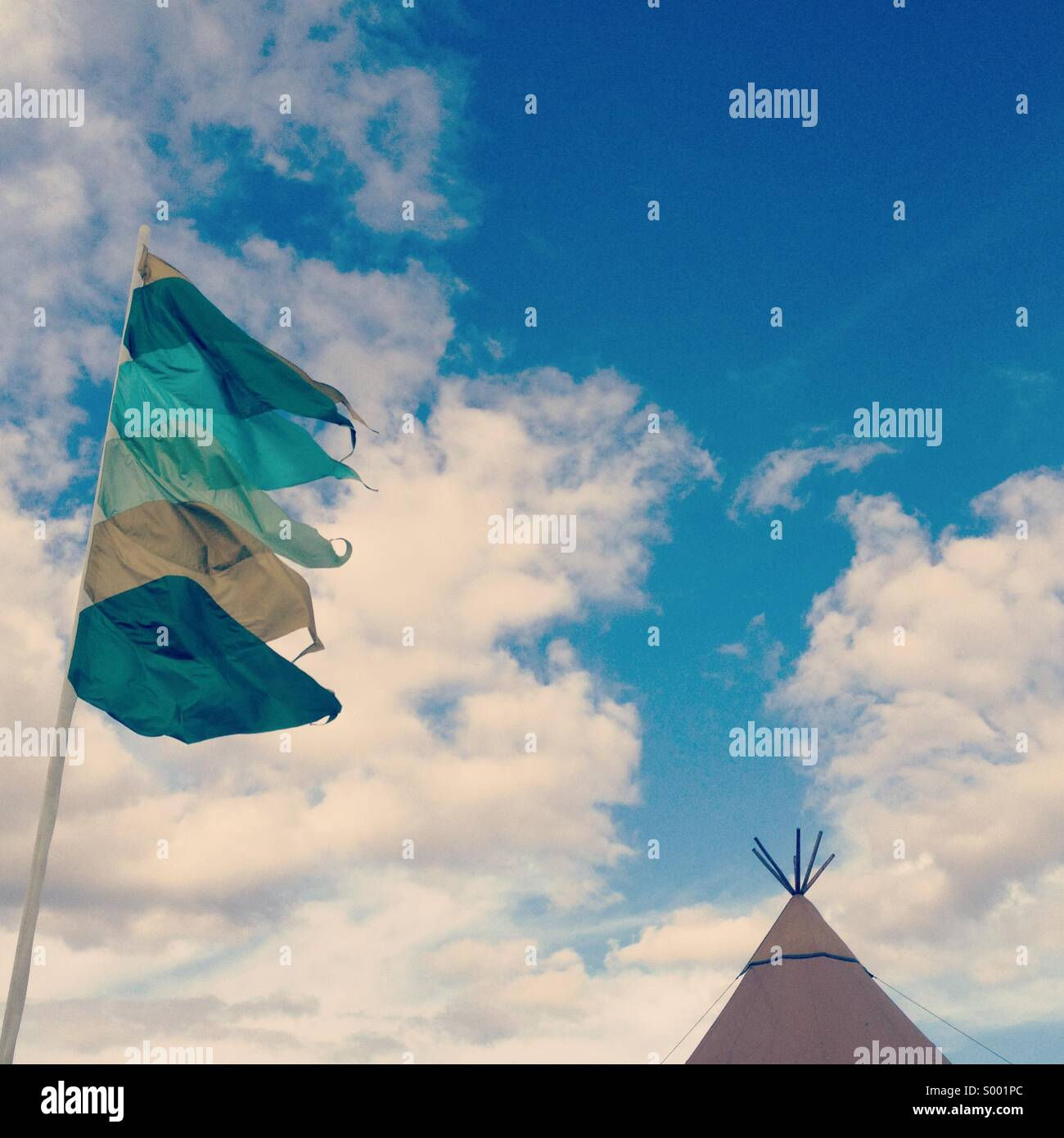 Tent and flags at a festival - Stock Image