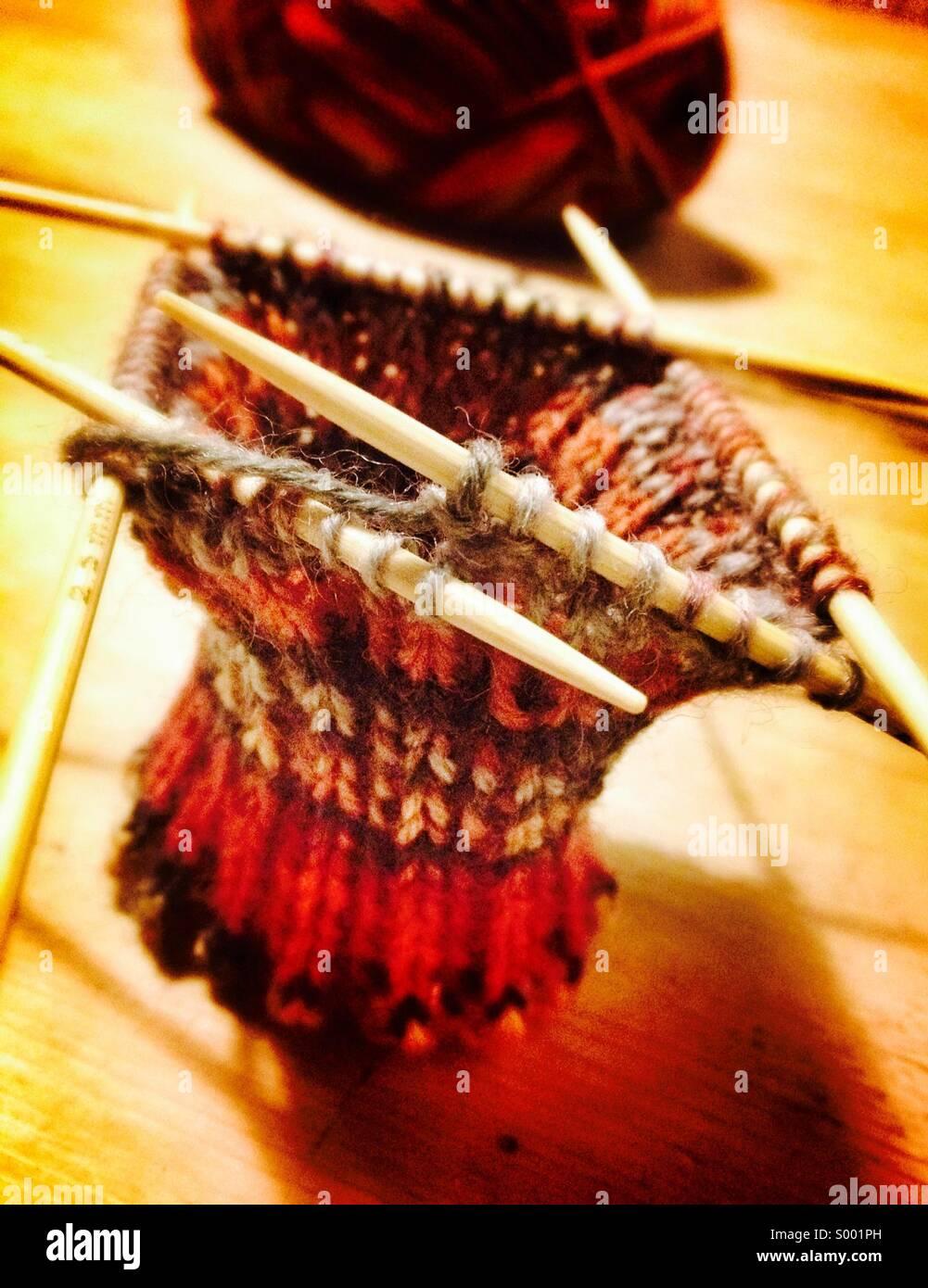 Knitting socks, close up of knitting needles and wool - Stock Image