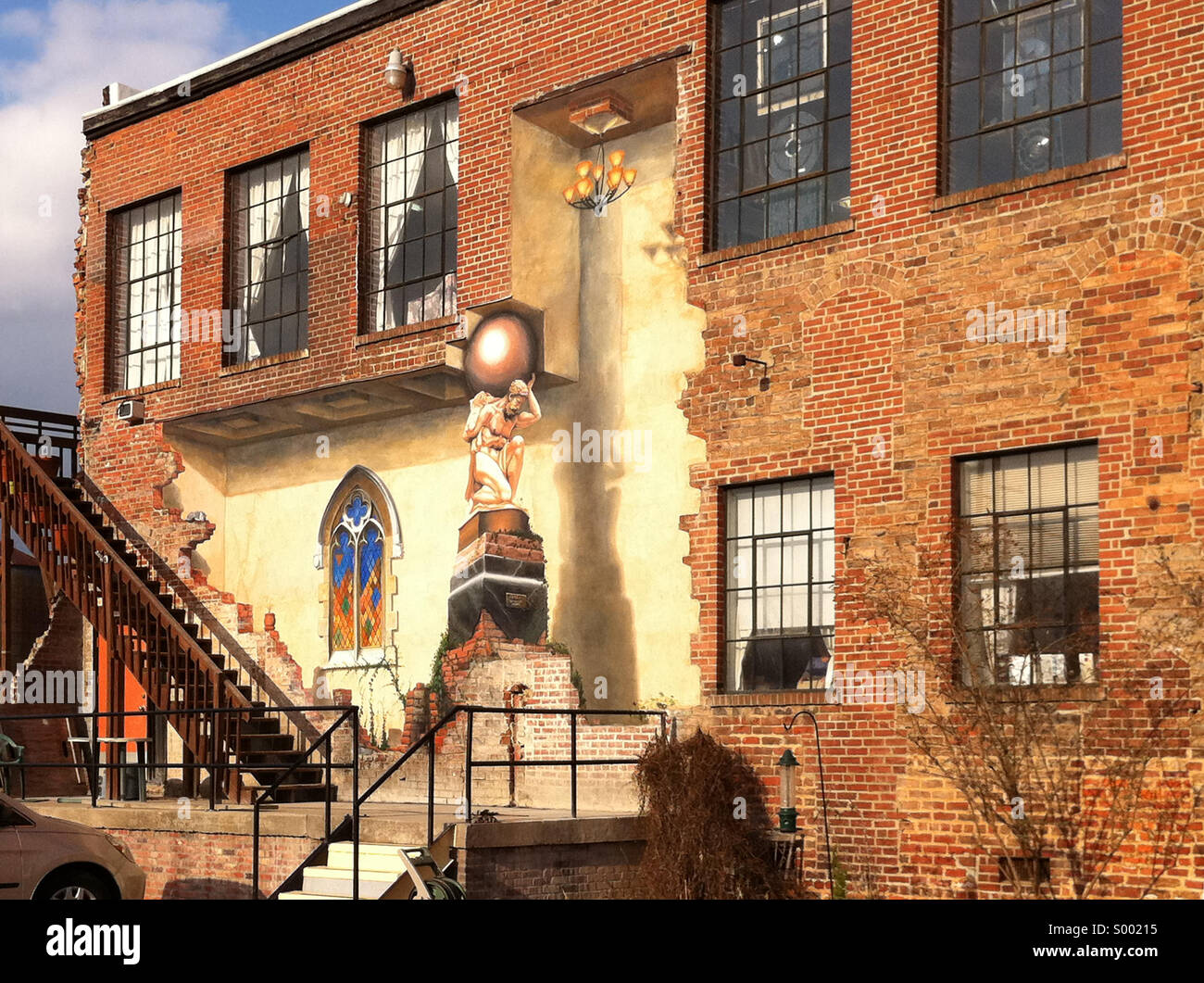 Trompe l'oeil (fool the eye) wall painting on a building in the River Arts District of Asheville, North Carolina. - Stock Image