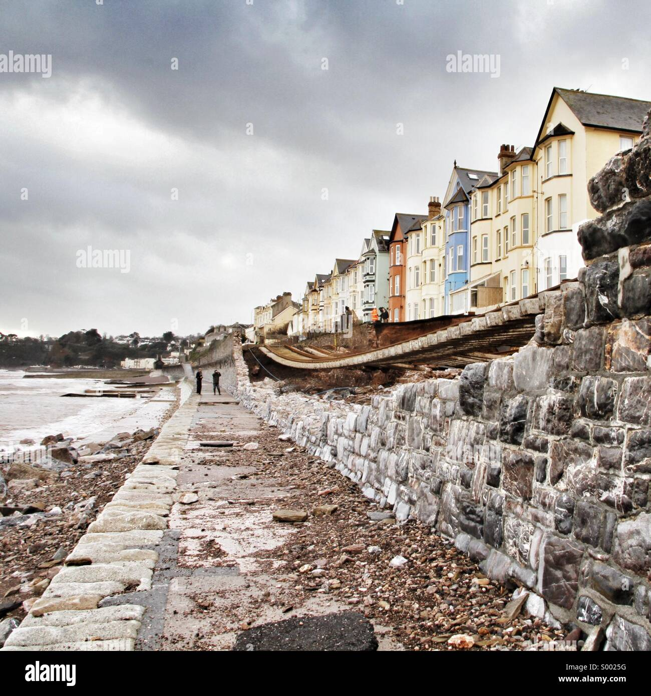 Dawlish railway line and sea wall destroyed by the sea during #ukstorm2014 - Stock Image