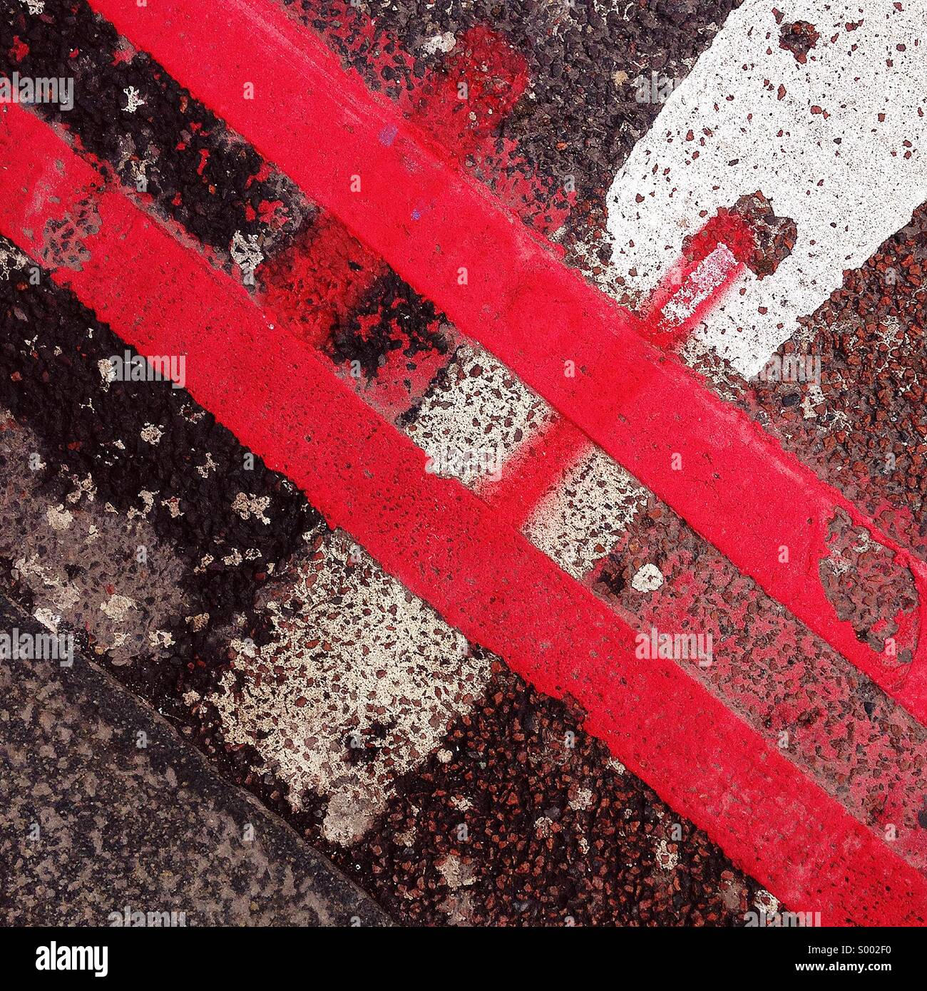 Road marking graffiti - Stock Image