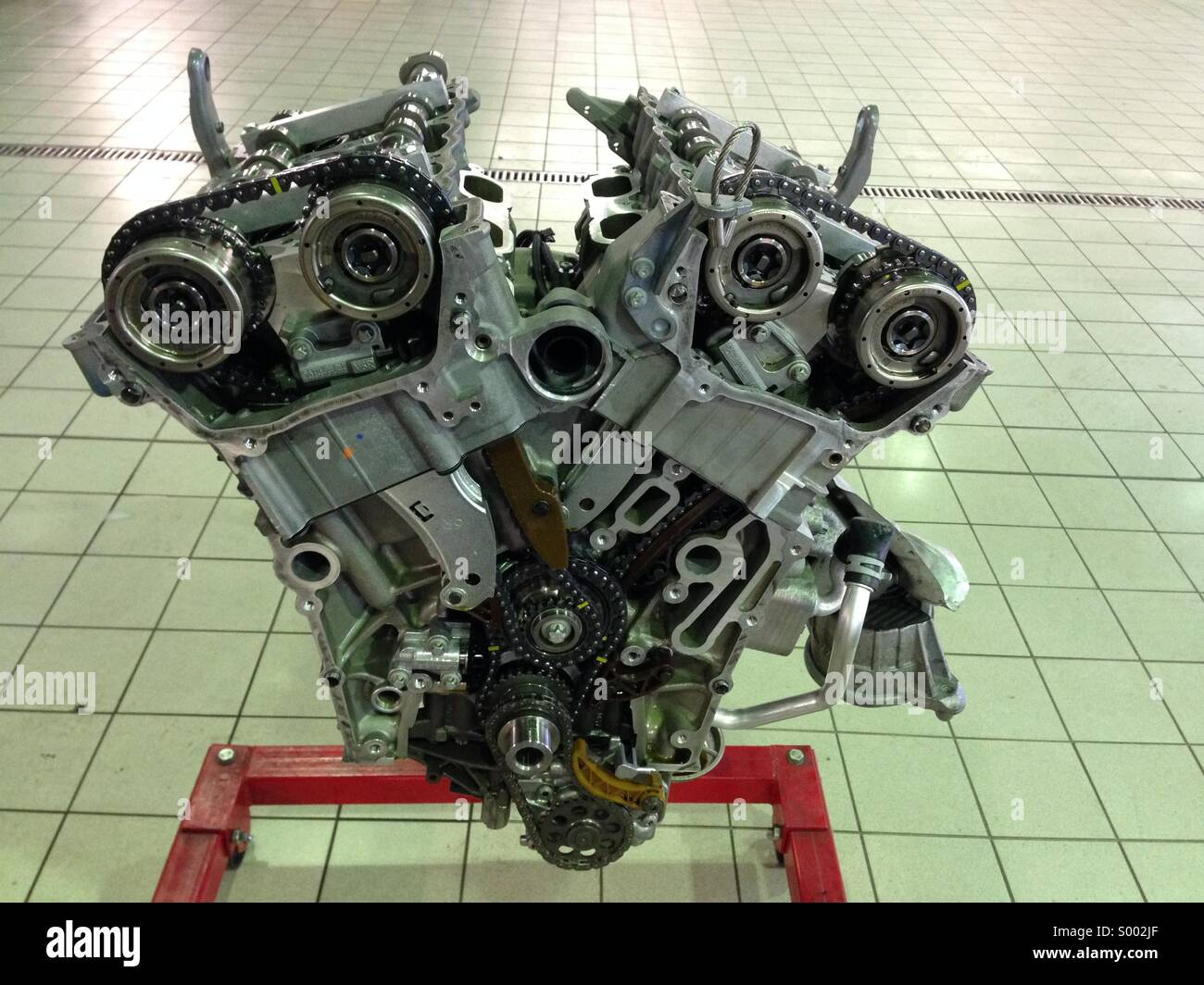 Front of engine timing chain exposed - Stock Image
