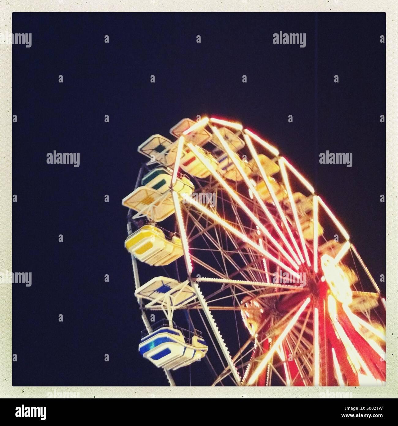 An amusement park Ferris wheel at night - Stock Image