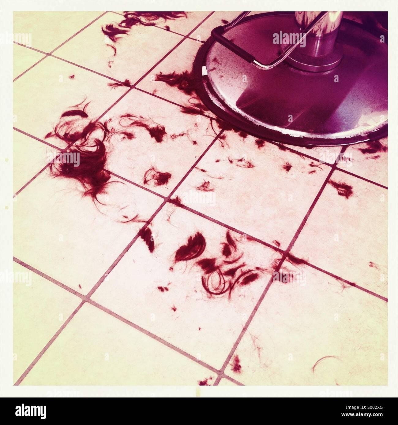 The floor beneath a haircut chair - Stock Image
