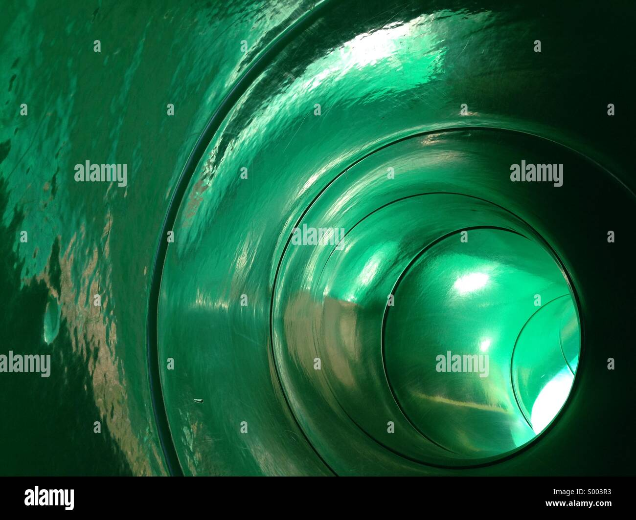 Child slide from point if entry - Stock Image
