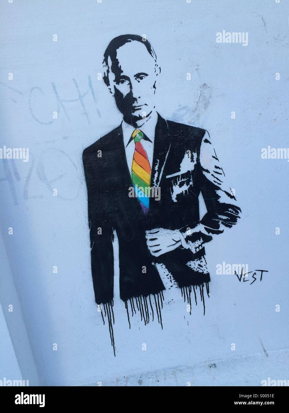 Vladimir Putin looking absolutely fabulous with his gay, rainbow tie. - Stock Image