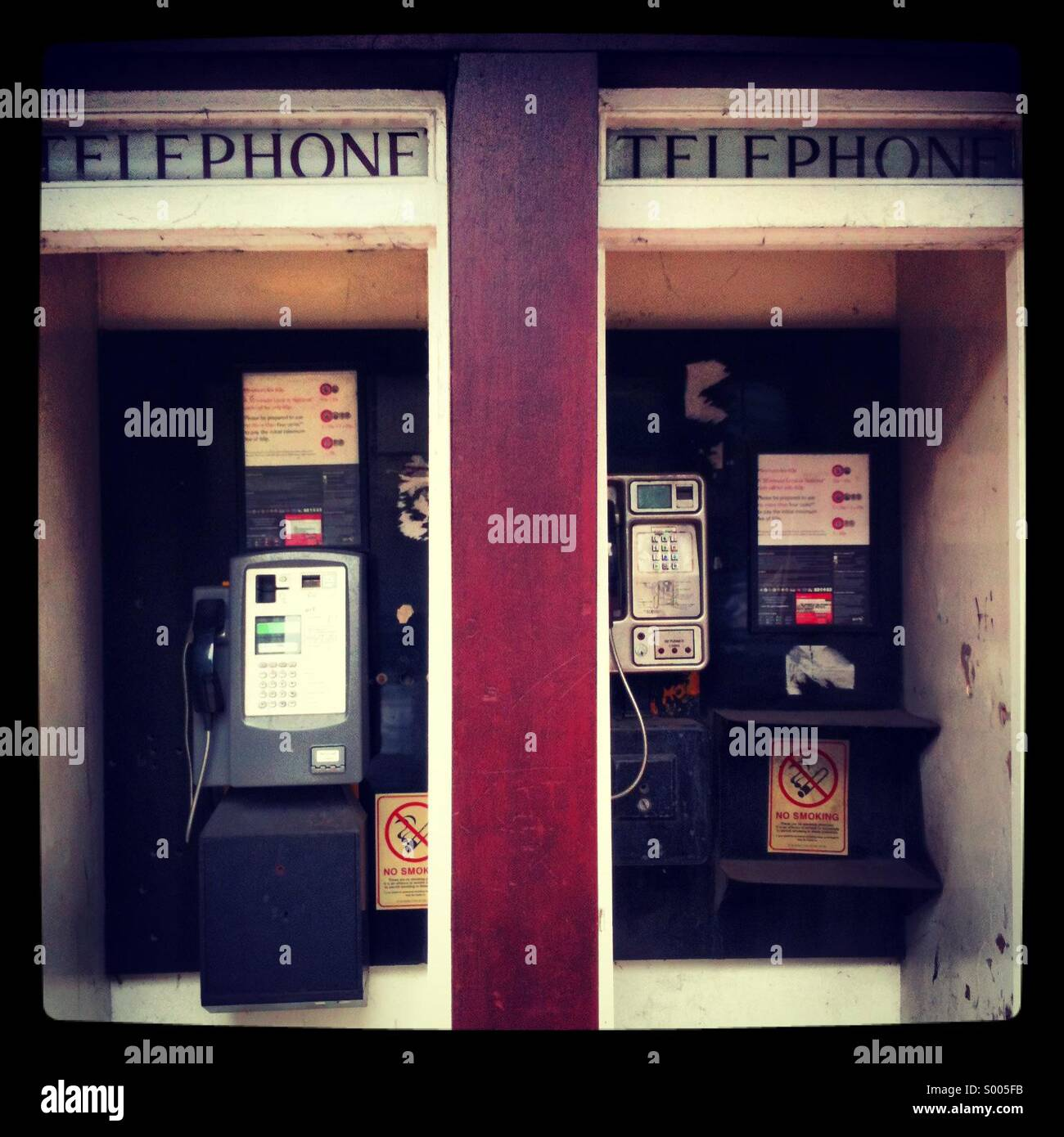 Old style telephone boxes kiosk - Stock Image