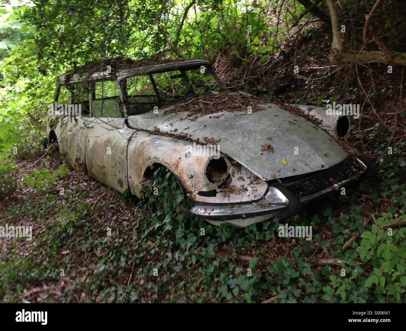 Bourganeuf, France: An old rusting classic car, a Citroen DS estate ...