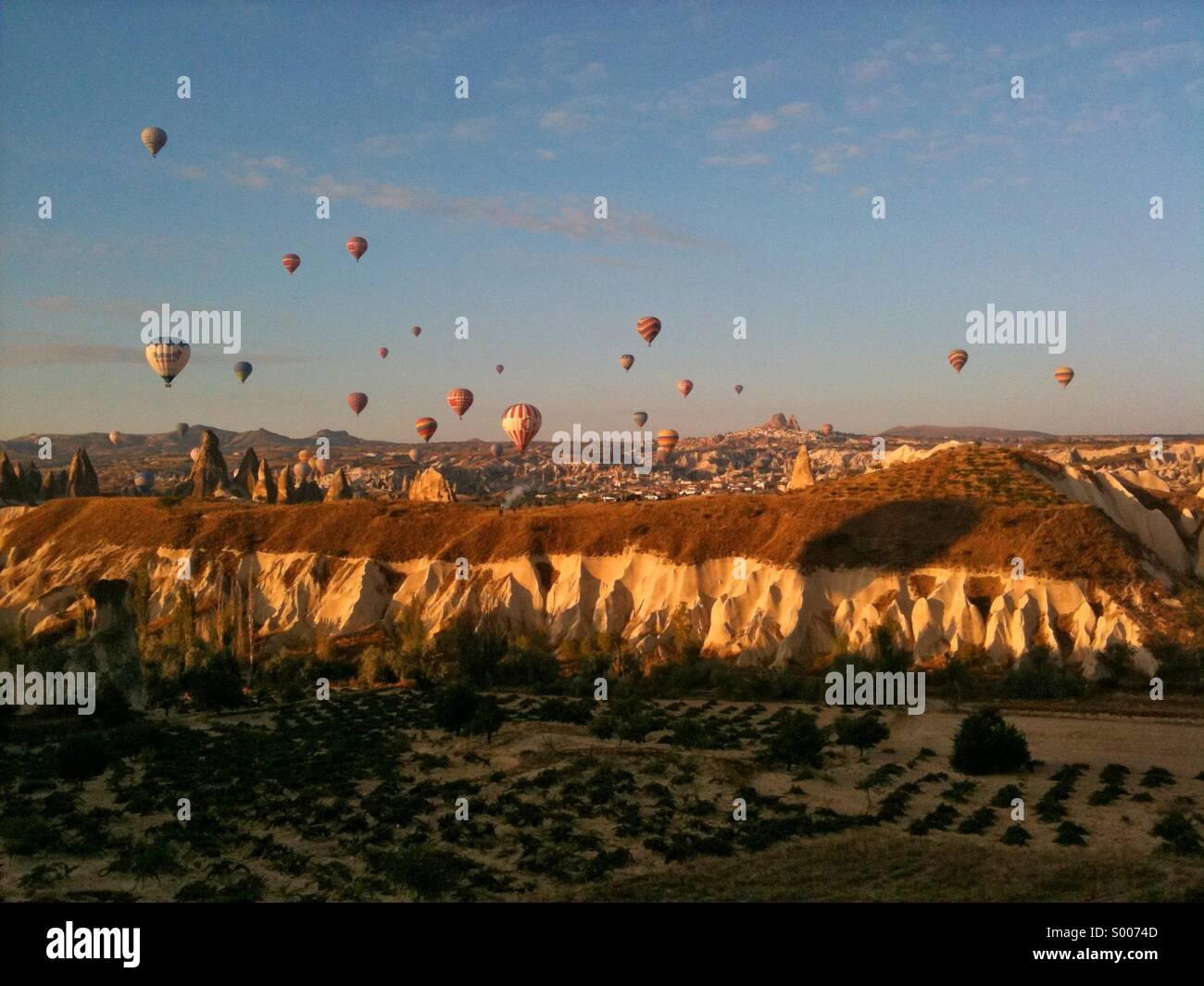 Hot air balloons over Goreme in Cappadocia, central turkey. - Stock Image