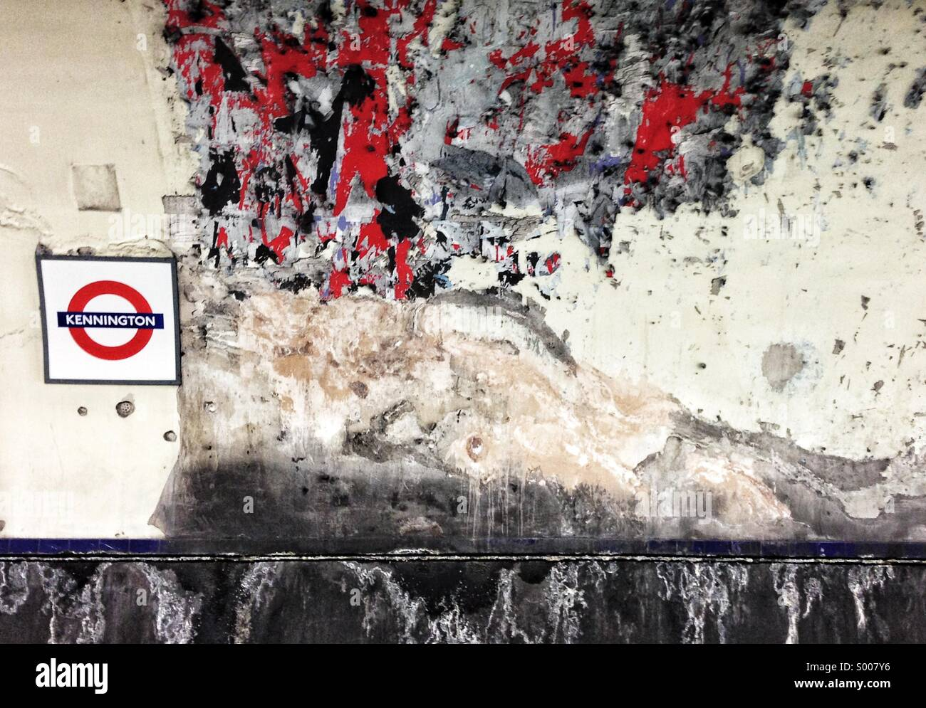 Kennington tube station after advertising posters have been cleaned off the tunnel wall - Stock Image
