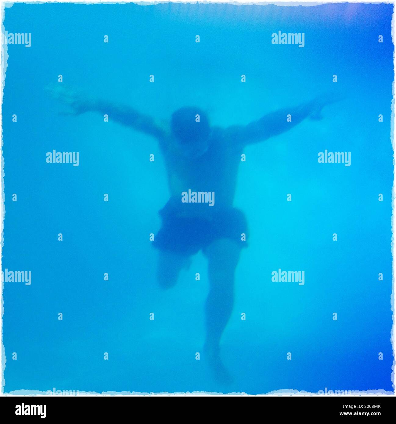 Underwater Shot of a Muscular Man - Stock Image