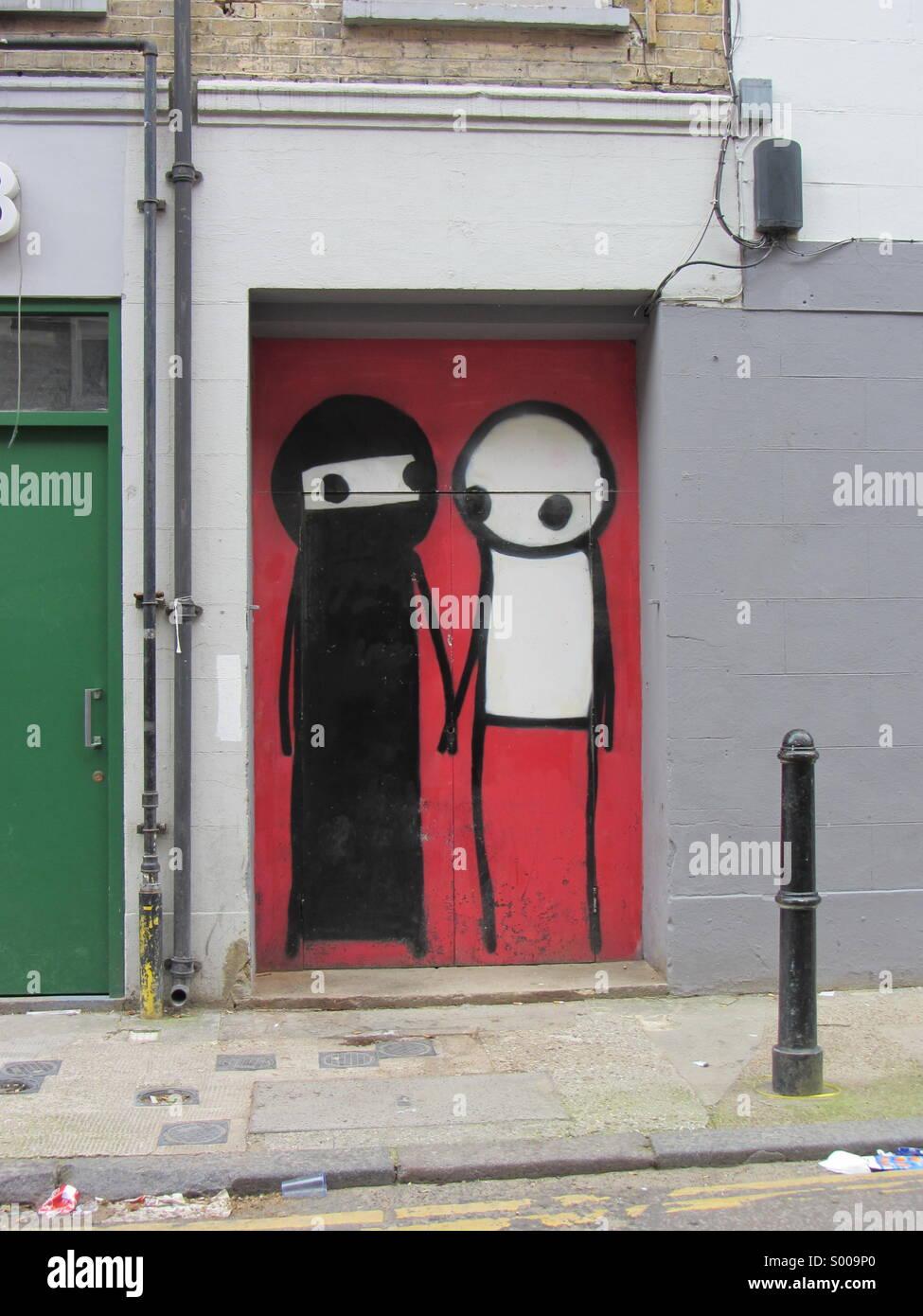 Street art Brick Lane stik - Stock Image