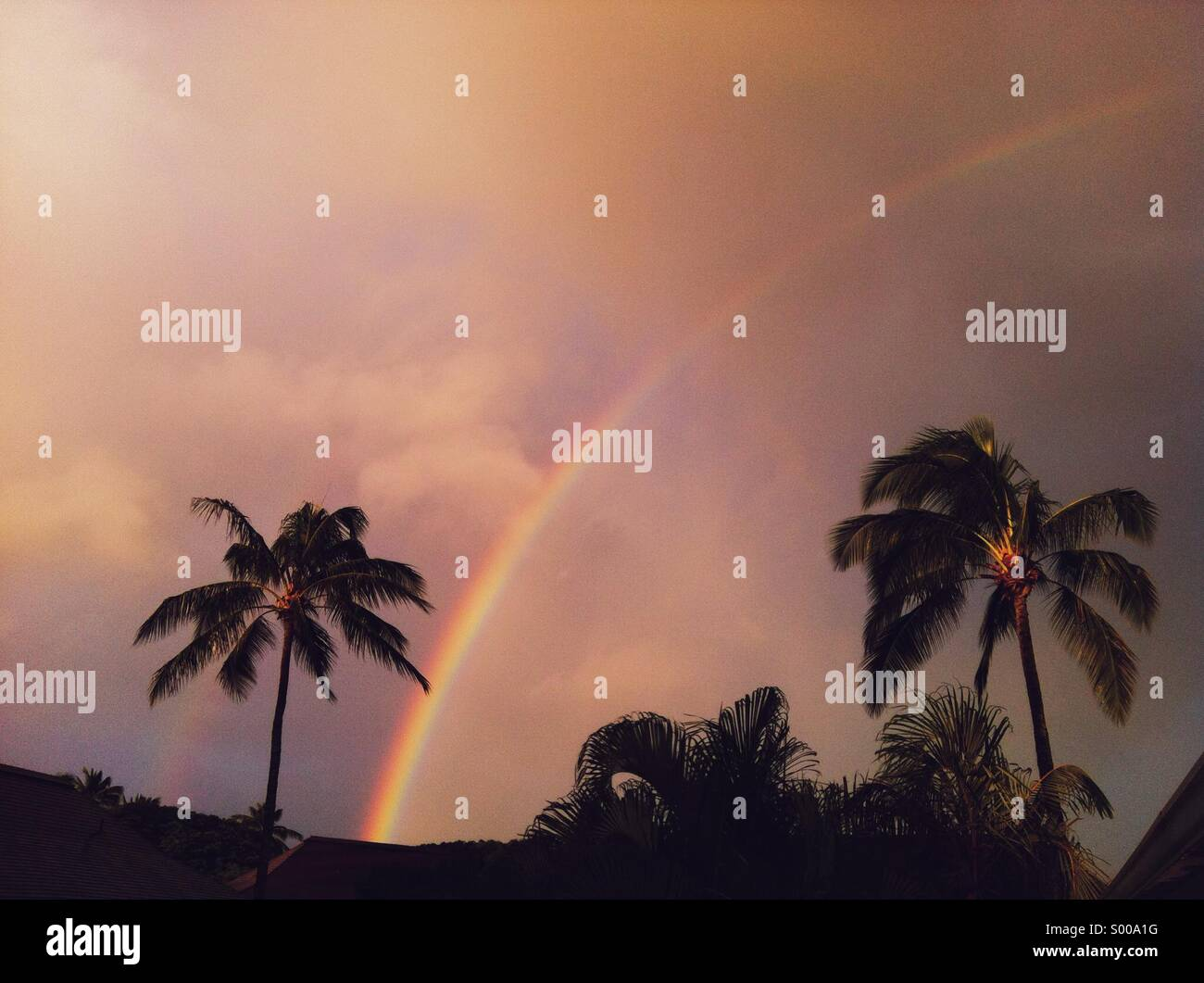 Rainbow after tropical storm Stock Photo