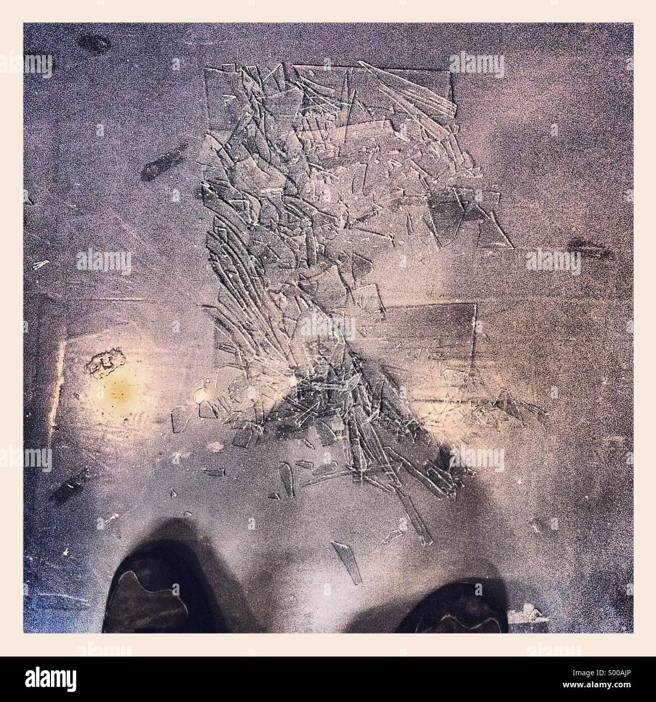 Broken glass on floor - Stock Image