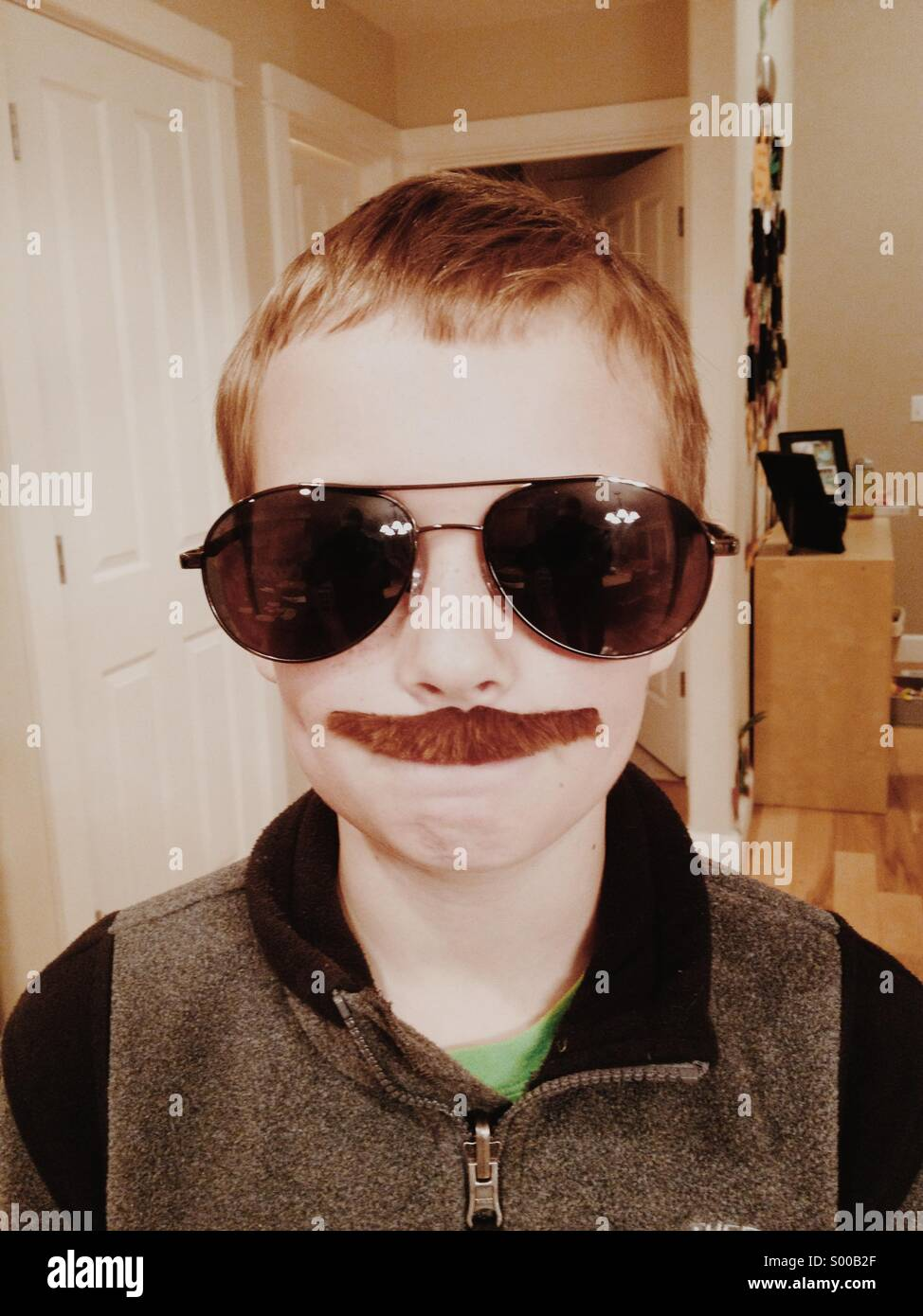 Kid with fake mustache and glasses Stock Photo