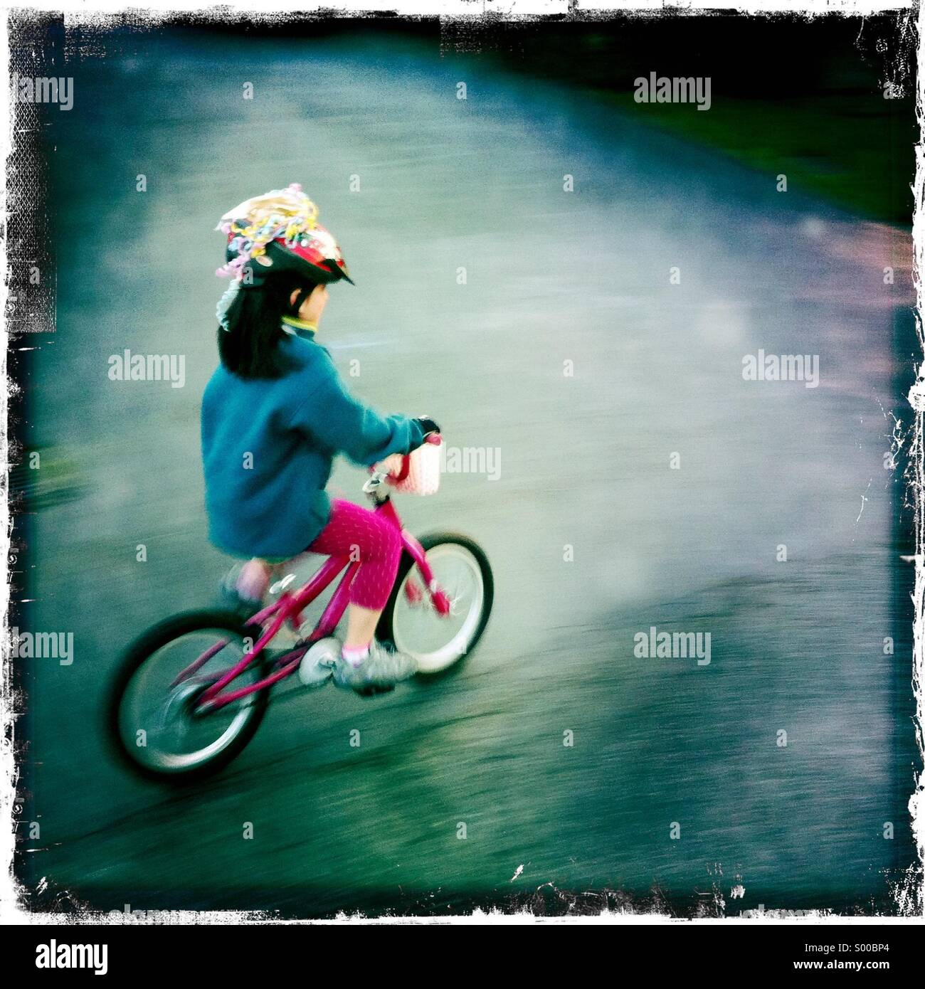 Girl riding bicycle. - Stock Image