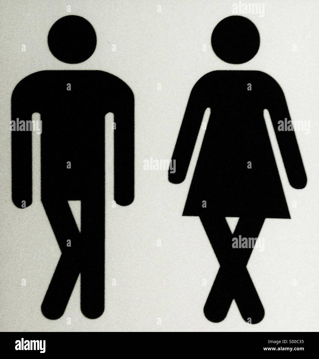 A sign showing male and female characters with crossed legs, needing to use a convenience. - Stock Image