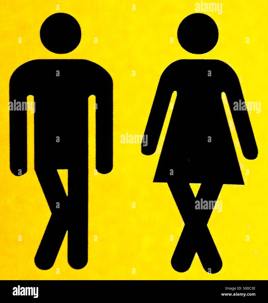 A sign showing a man and a woman with crossed legs. - Stock Image