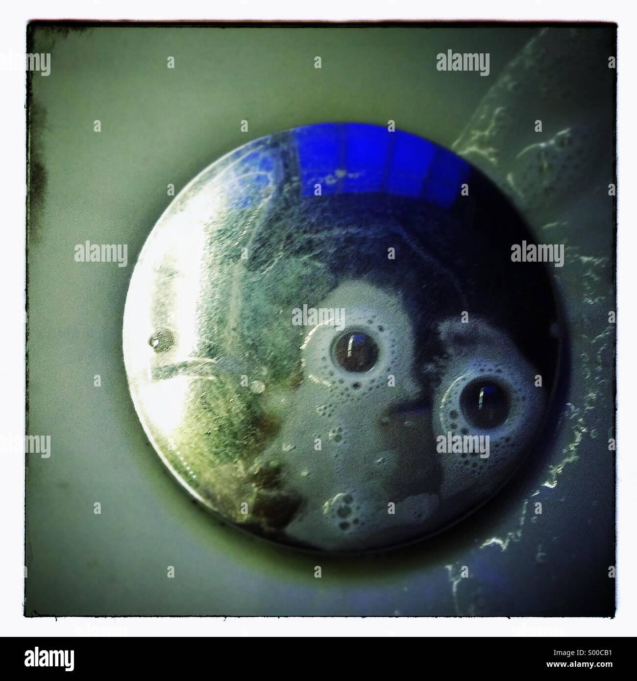 Eyes soap bubbles in a sink basinStock Photo