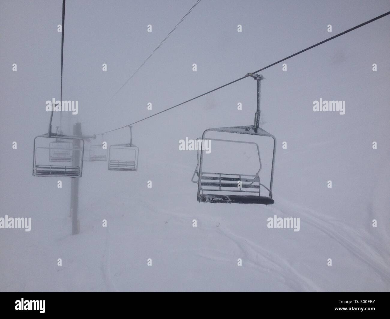 Chairlifts in the clouds Stock Photo