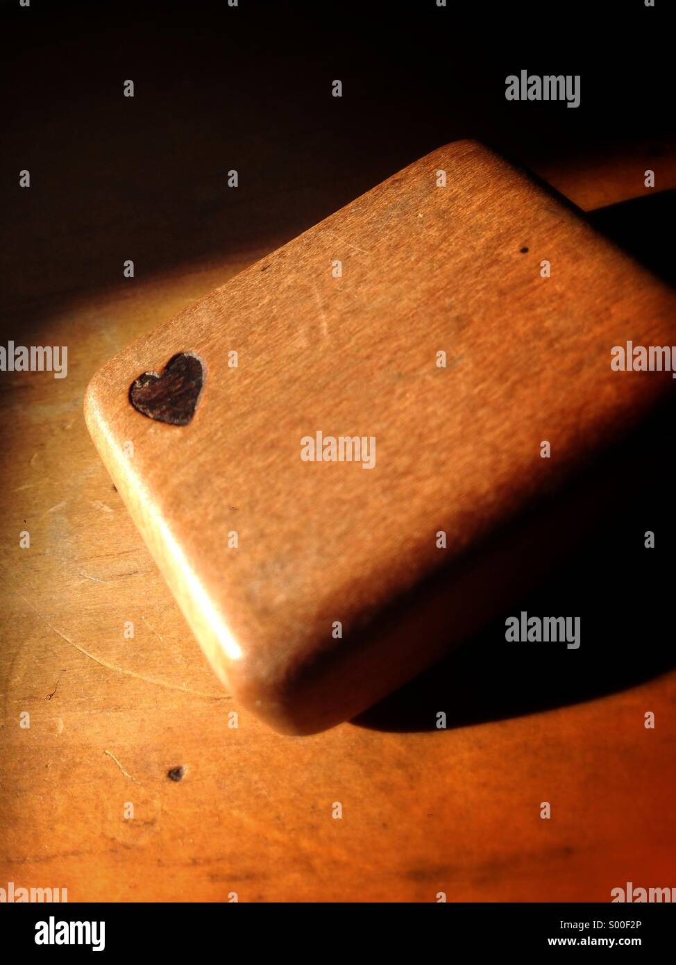 Small wooden box with a heart burned into it. Stock Photo