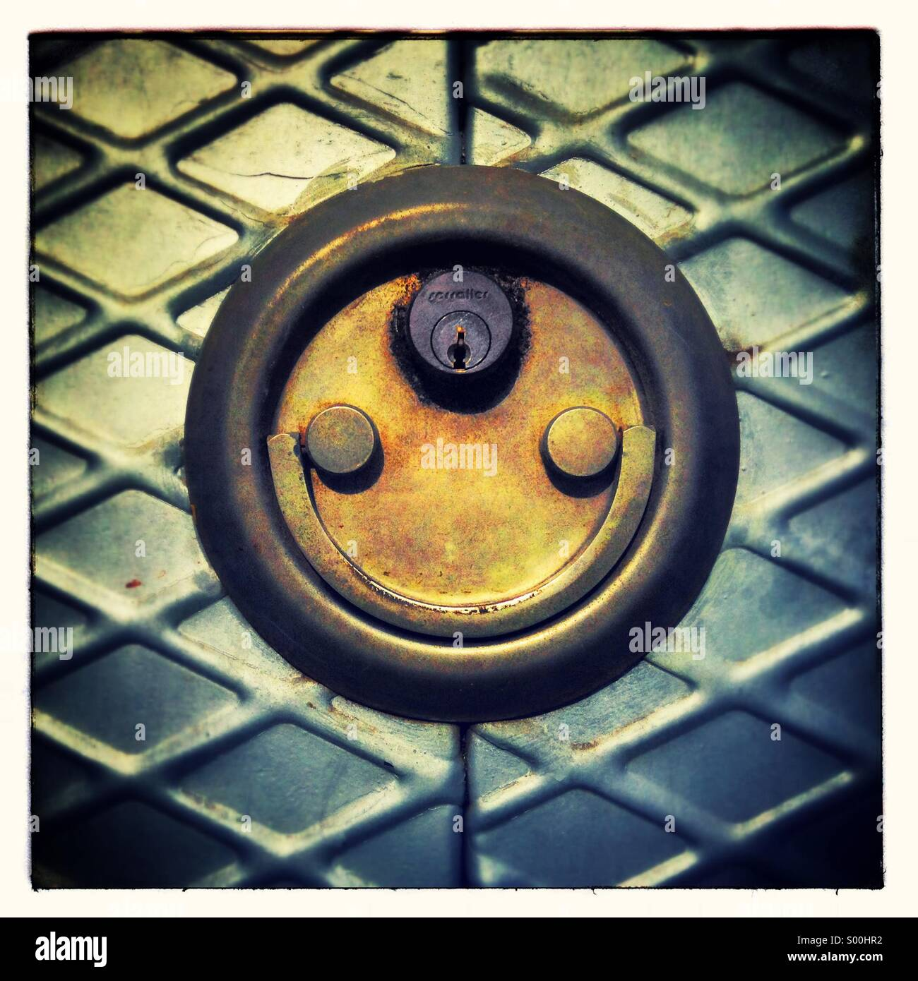 Door lock padlock smiling. Faces in objects - Stock Image