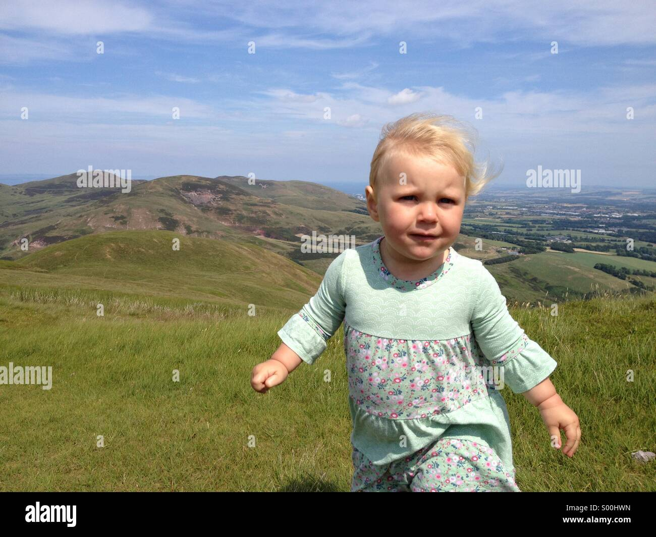 Toddler in the Pentland Hills on a warm sunny day - Stock Image