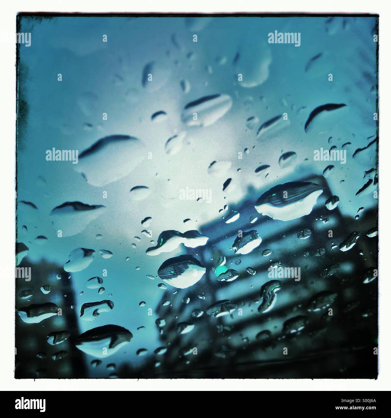 Drops of water on a car glass. Faces in objects.Stock Photo