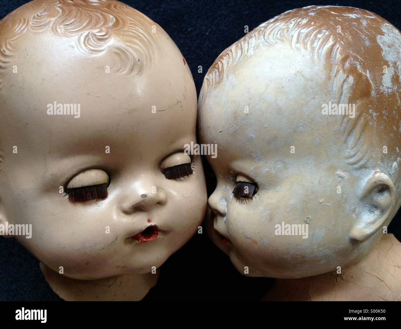 Two old doll heads - Stock Image
