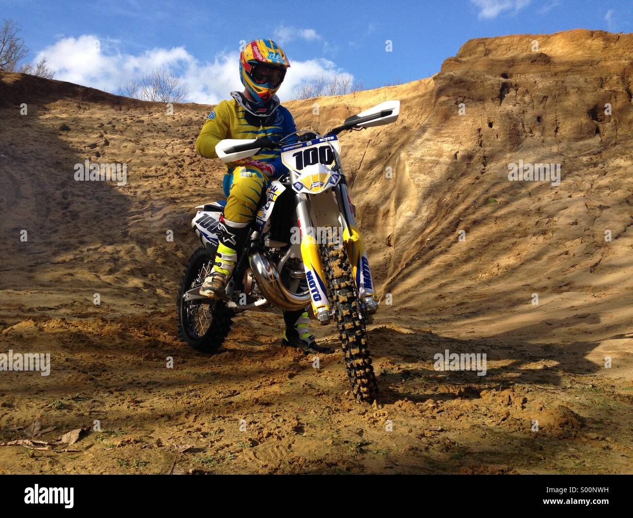 Extreme sport motocross rider on husky husqvarna bike is sand quarry Stock Photo