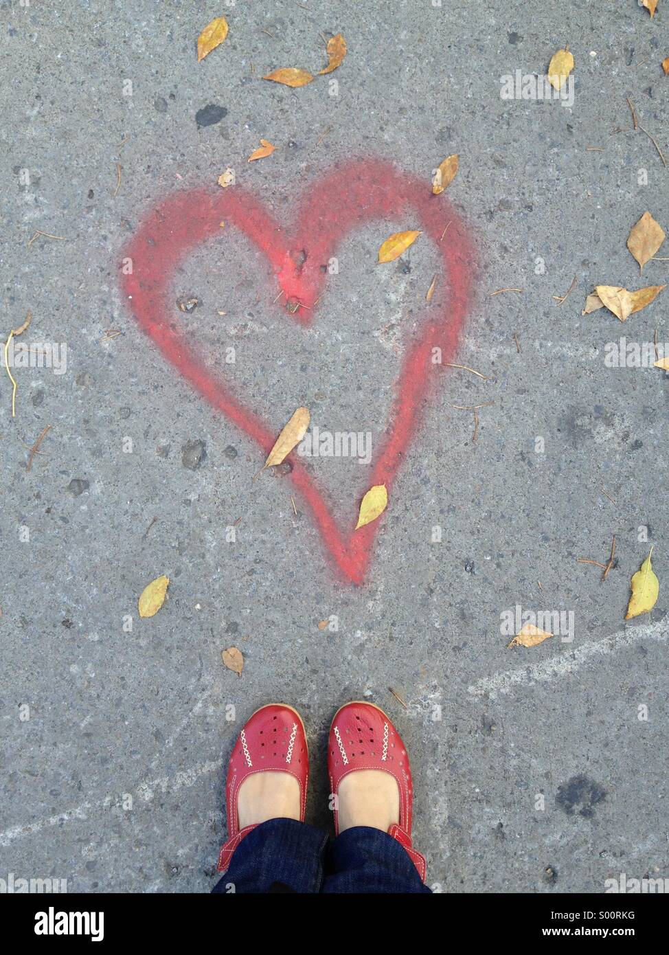 Red shoes and heart - Stock Image