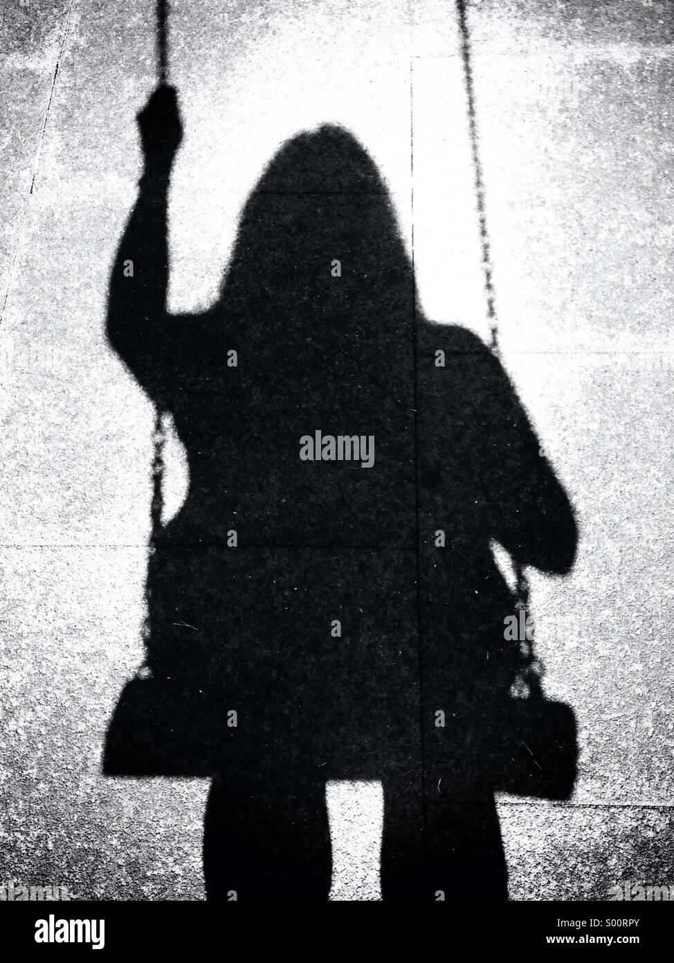 Swinging shadow - Stock Image