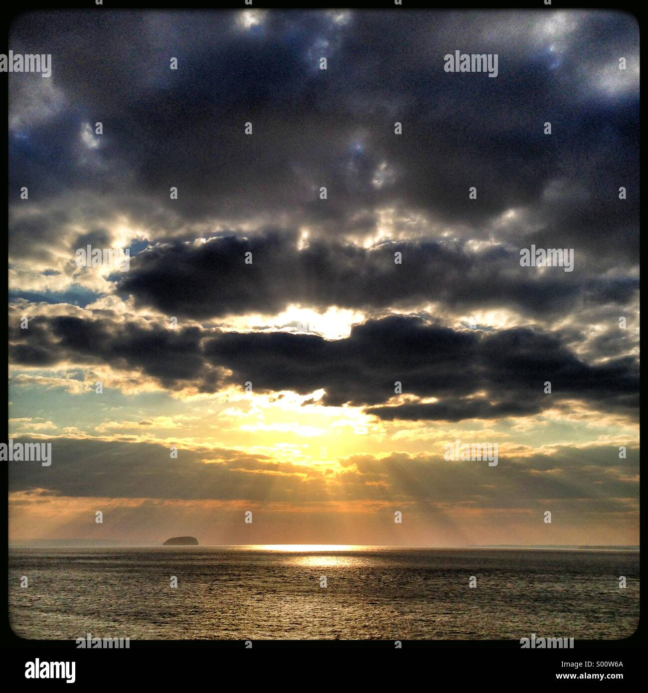Dramatic sunset looking out to sea - Stock Image