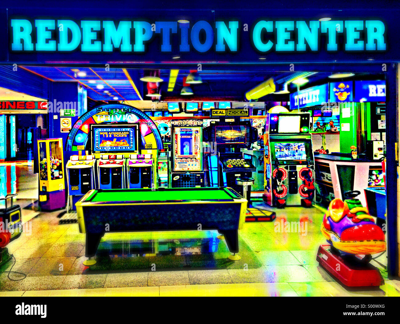 Redemption Center - a colourful but deserted amusement arcade in the Canaries - Stock Image