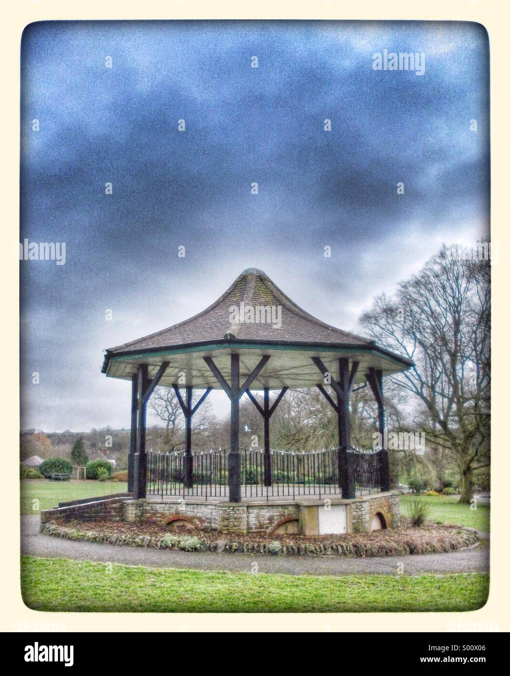 Old-fashioned bandstand in a park in winter - Stock Image