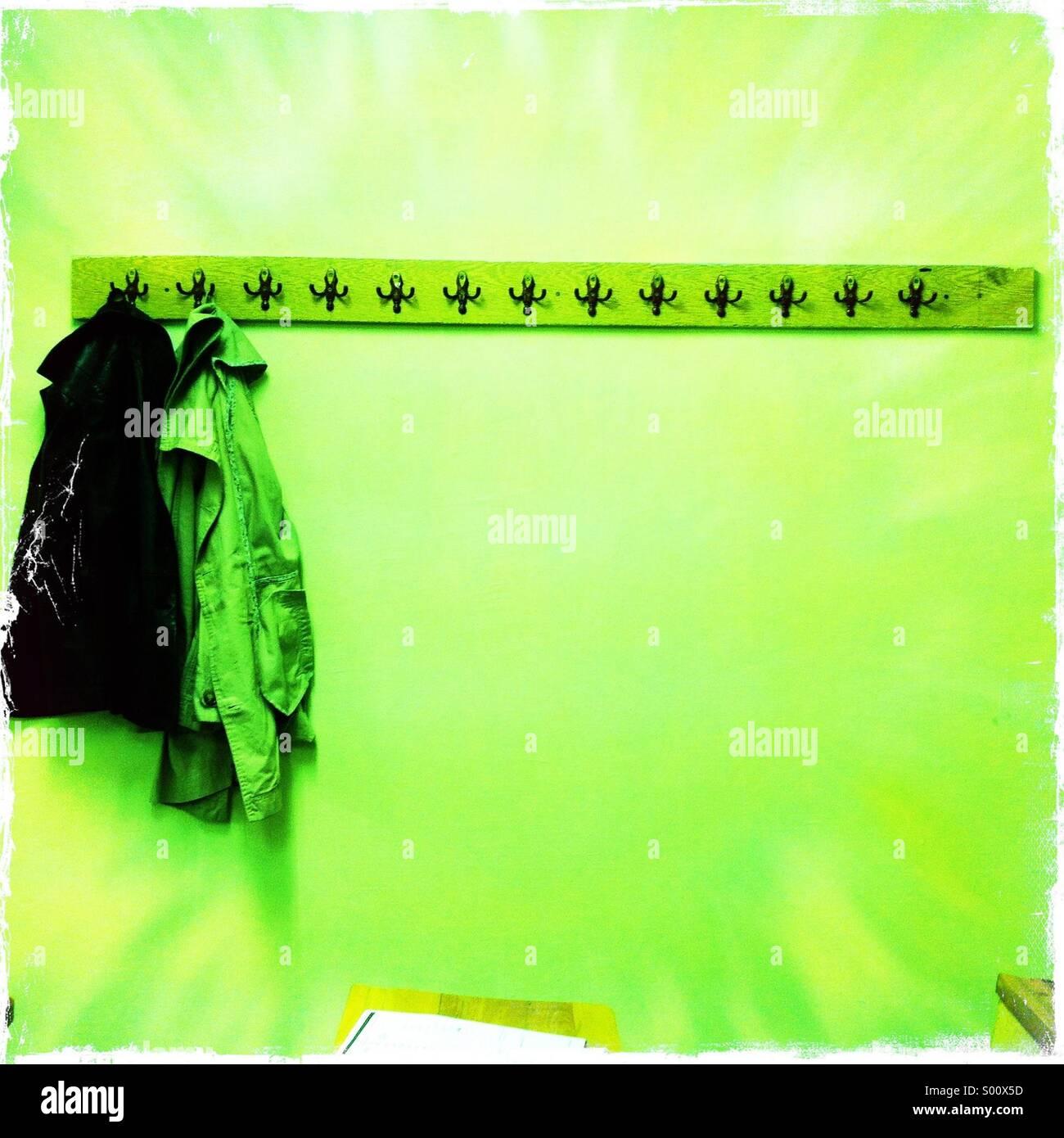 Raincoats on hang - Stock Image