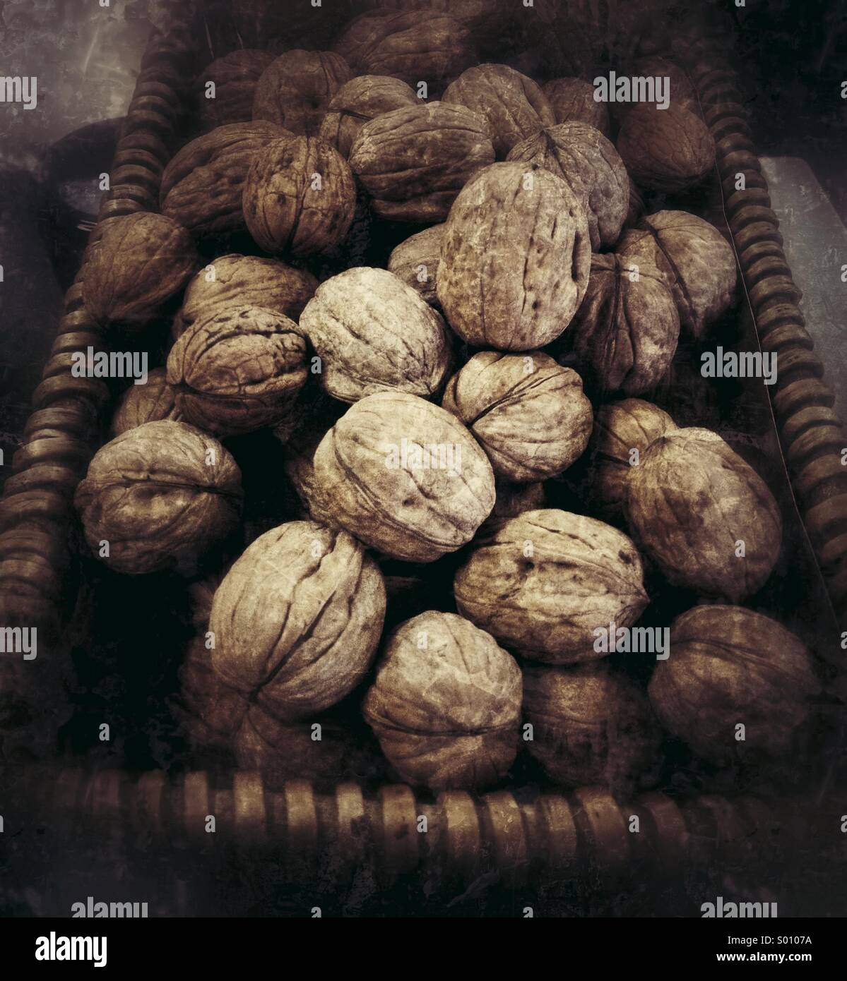 Basket of walnuts - Stock Image