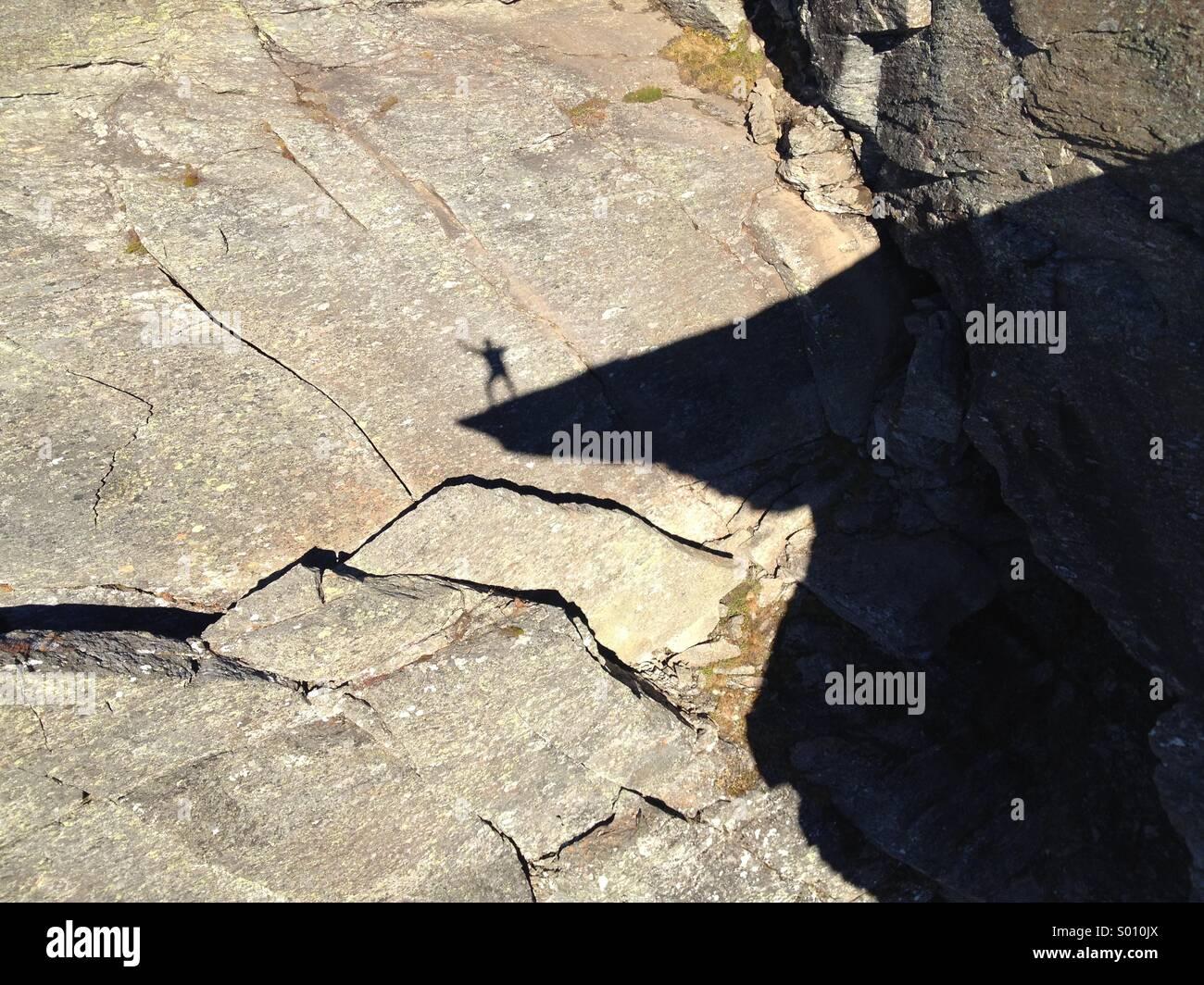 Man shadow dancing on Trolltunga, tyssedalen, Odda, Norway. Stock Photo