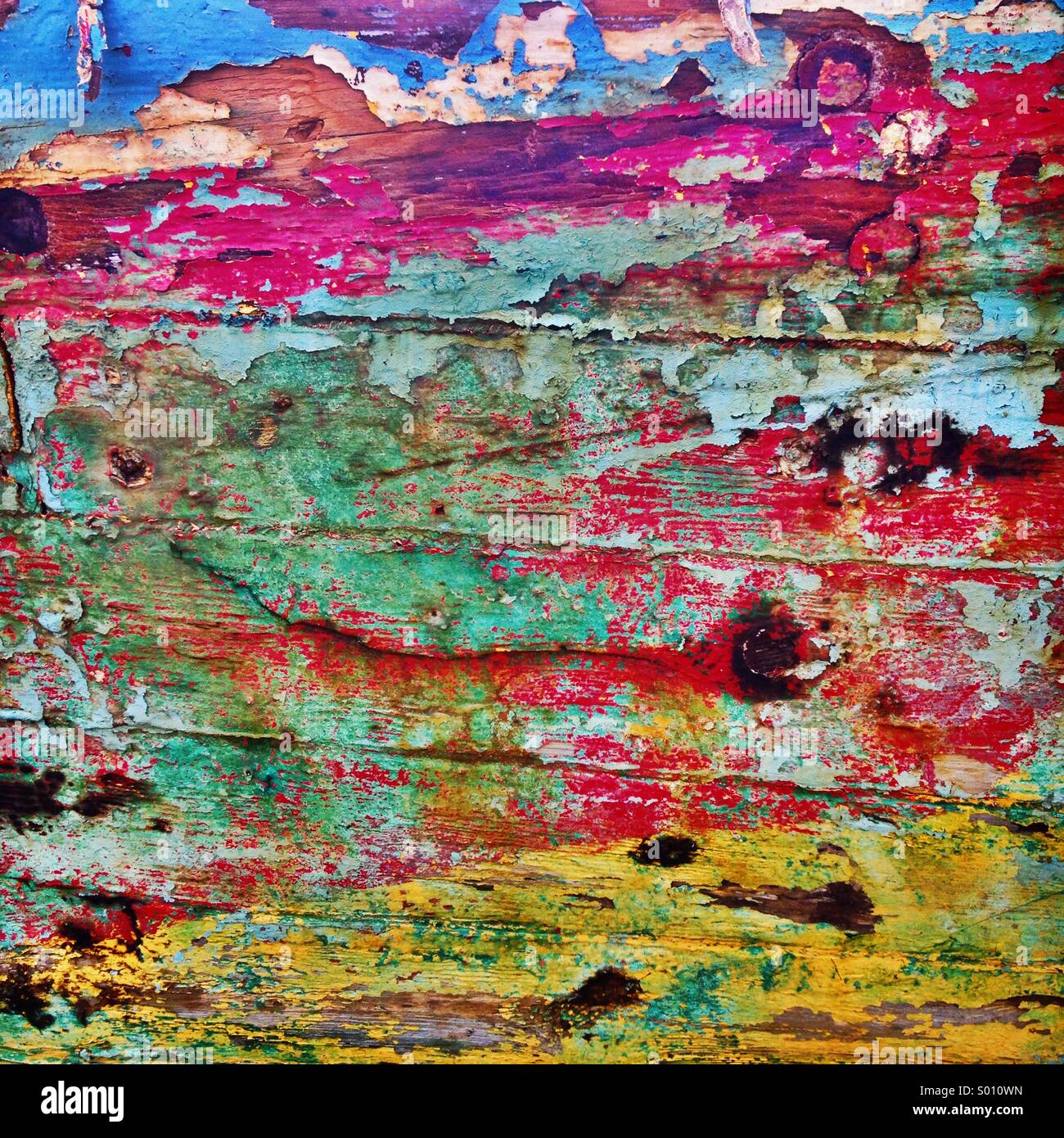 Distressed paint on abandoned wooden shipwreck - Stock Image