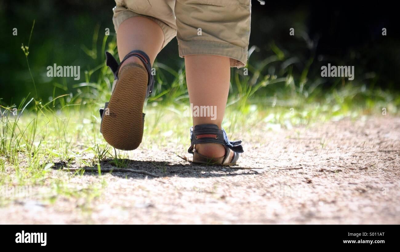 Young boy walking away - Stock Image